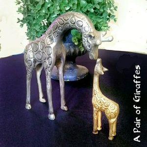 Pair of metal giraffes nuzzling